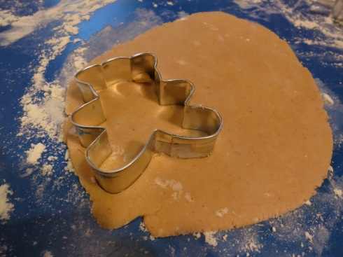 Cutting out a lebkuchen bear.  The dough is rather sticky, so make sure your counter is well floured!