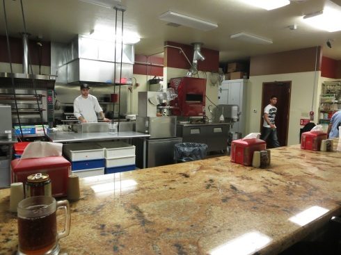 A view into the kitchen at Borgata. The open kitchen really makes the space feel open and welcoming.