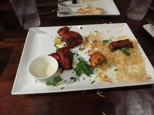 "This is what happened when we were first presented with food from Tandoori Grill: we gobbled it up without time to take ""before"" pictures."