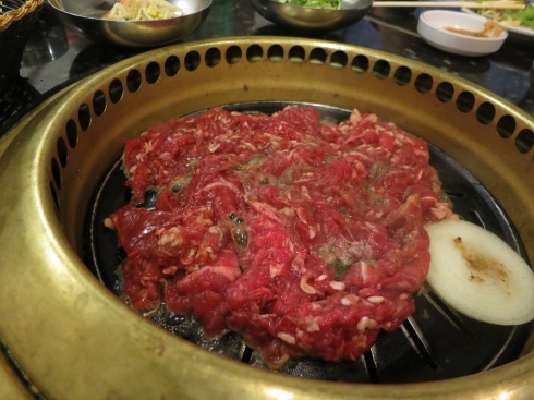 Bulgolgi being grilled at the table.