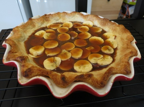 Bottom of the pie: bananas covered in the caramel rum sauce.