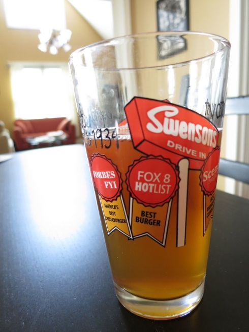 """My pint glass listing the many awards Swenson's has won over the years.  It was impossible to capture them all. But look closely and you can see that they were named """"America's Best Cheeseburger."""""""
